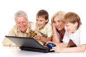 Grandchildren with their gorgeous granddad and granny — Stock Photo