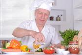 Elderly man chef — Stock Photo