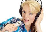 Honey blonde in headphones — Stock Photo