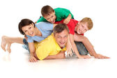 Tops family in bright T-shirts — Stock fotografie