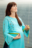Happy pregnant woman in a blue — Foto Stock
