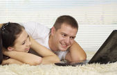 Beauteous young people at home — Stock Photo
