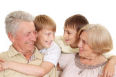 Granddad and granny with their adorable grandchildren — Stock Photo