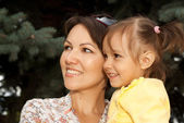 Amusing mother and daughter in the forest — Stock Photo