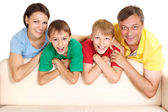 Superb family in bright T-shirts — Stock fotografie