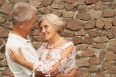Good-looking elderly couple in the city — Stock Photo