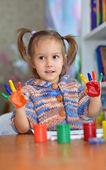 Cute child draws paints — Stock Photo