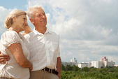 Dreaming elderly couple went for a walk — Stock Photo
