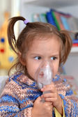 Portrait of a cute baby makes inhalation — Stock Photo