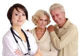 Enfermeira simpática com idosos — Foto Stock