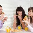 Pleasant people eat the pizza — Stock Photo