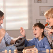 Boy with his parents playing lotto  — Stock Photo