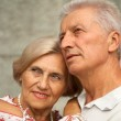 Charming elderly couple in the town — Stock Photo