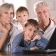 Two boys with their grandparents — Stock Photo