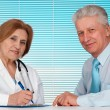 Stock Photo: Great doctor and her patient