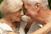 Amusing elderly couple sitting on the veranda — Stock Photo