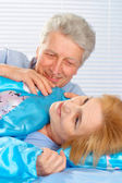Pleasant older couple resting in the bedroom — Stock Photo