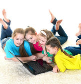 Cheerful girlfriends with laptop — Stock Photo
