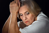 Wistful older woman — Stock Photo