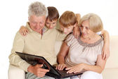 Granddad and granny with their glorious grandchildren — Stock Photo