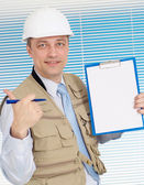 Glorious man working in the construction helmet — Stock Photo