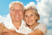 Good-looking elderly couple went for a walk — Stock Photo