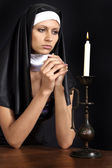 Quiet girl dressed as a nun — Stock Photo