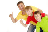 Playful family in bright T-shirts — Stock Photo