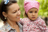 Tops woman with daughter — Stock Photo