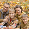 Family of four in park — Stock Photo