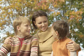 Mom and her children in autumn — Stock Photo