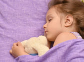 Little girl sleeping in her bed — Stock Photo