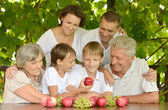 Happy family at table in summer — Stock Photo