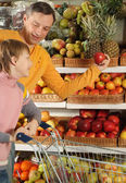 Fun boy with dad in the store — Stock Photo
