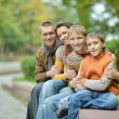 Family of four sitting — Stock Photo