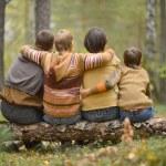 Family of four picking — Stock Photo