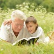 Grandfather and his grandson — Stock Photo #33354575