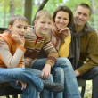 Family of four sitting — Lizenzfreies Foto
