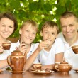Family drinking tea — Foto Stock