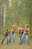 Family of four playing — Stock Photo