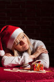 Santa girl with gift — Stockfoto