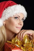 Good-looking lady dressed as Santa — Stock Photo