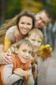 Smiling family walks — Stock Photo