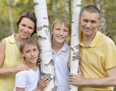 Happy family walking — Stock Photo