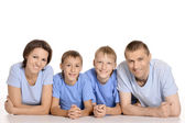 Frendly family on the floor — Stock Photo