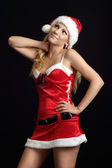 Charming woman dressed as Santa — Stock Photo