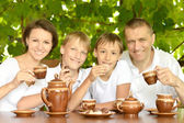 Family drinking tea — Stock Photo