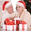 Elderly couple celebrating new year  — Stock Photo