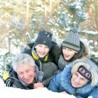 Familyin winter park — Stock Photo