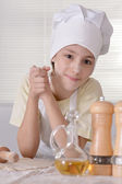 Boy knead the dough — Stock Photo